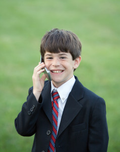 Little Boy Dressed up Talking on Cell Phone